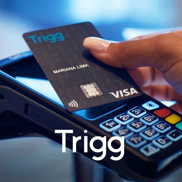 Close up of a person using a Visa card with a Trigg logo on it to make a point of sale transaction.